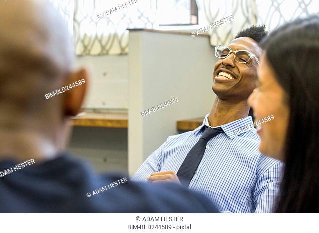 People laughing in meeting
