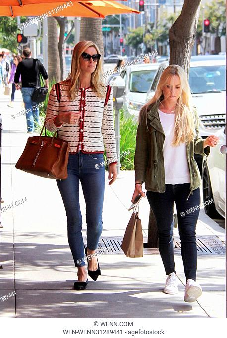 Nicky Hilton wears a classic ensemble with a leather tote and knit cardigan while running errands with a friend Featuring: Nicky Hilton Where: Beverly Hills
