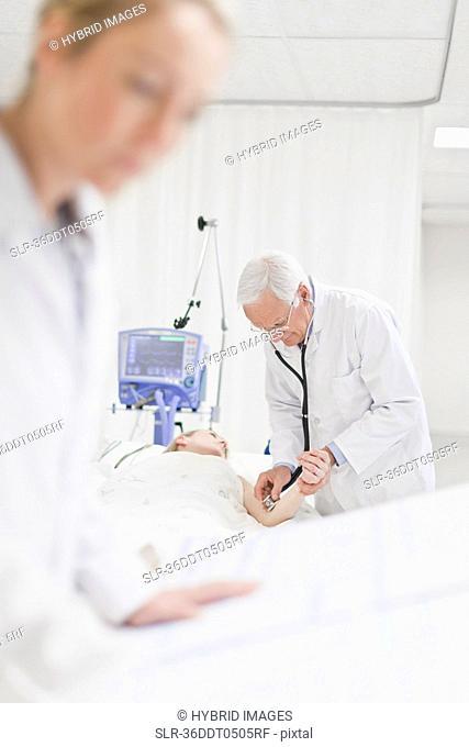 Doctor tending to patient in hospital