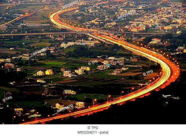 Traffic light trail of freeway. Aerial view from Shuangfeng Cihuitang; Tongluo; Miaoli; Taiwan