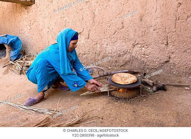 Ksar Elkhorbat, Morocco. Amazigh Berber Woman Baking Bread