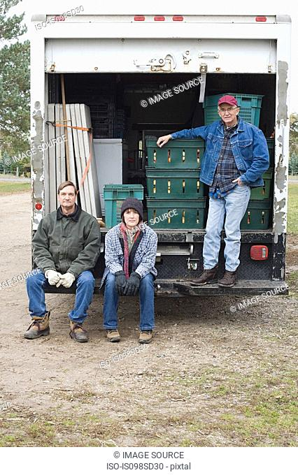 Three farmers by truck