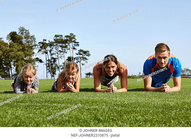 Family exercising together