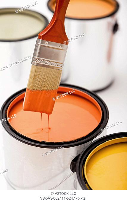 Studio shot of paint brush and paint cans