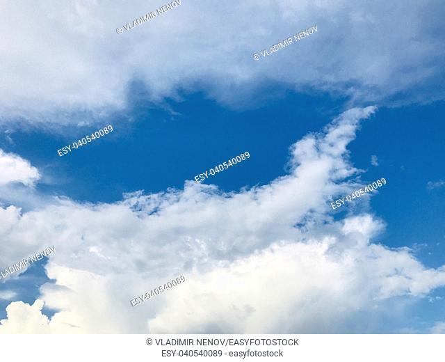 Blue sky filled with fluffy white clouds