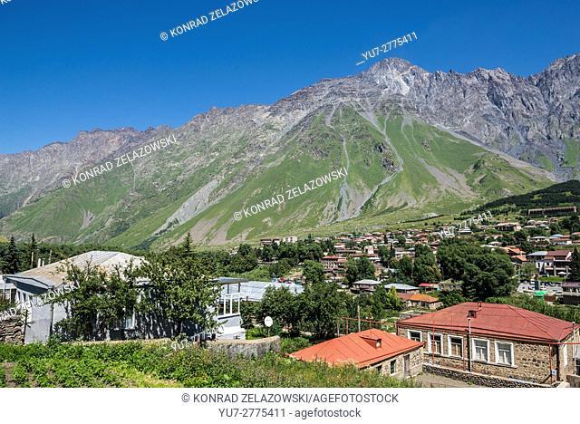 View on Gergeti village and Stepantsminda (former Kazbegi) town in Mtskheta-Mtianeti region, Caucasus Mountains, Georgia