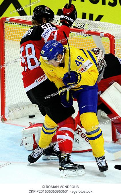 Victor Rask (SWE), centre, and David Savard (CAN), left, and goalkeeper Mike Smith (CAN), right, in action during the Ice Hockey World Championship Group A...