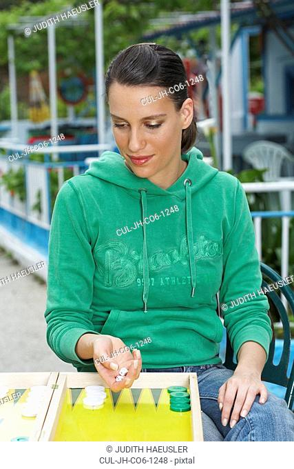 Woman playing backgammon