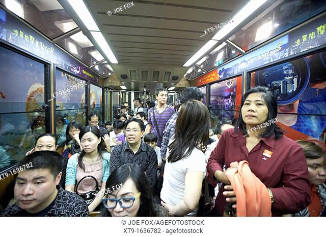 chinese people in the peak tram leaving the station hong kong hksar china asia