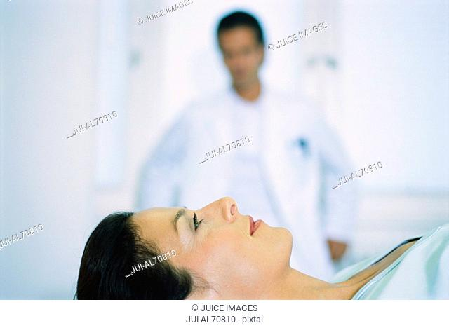 Portrait of a young female patient on a stretcher