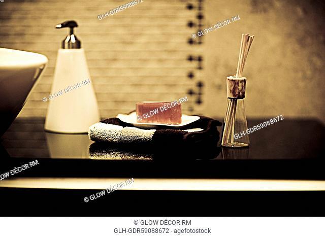 Toiletries near a wash bowl