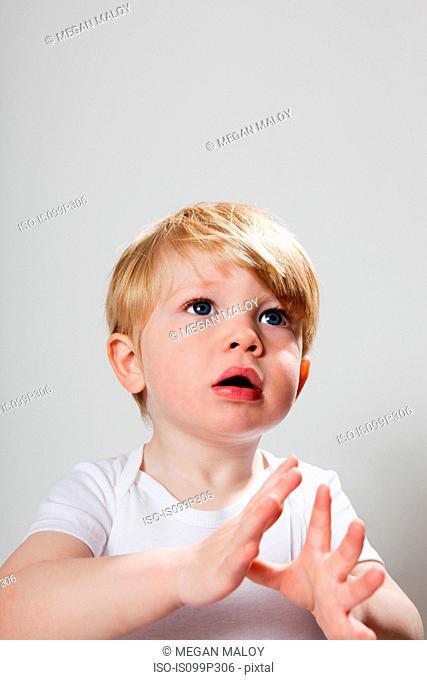 Boy gesturing with hands