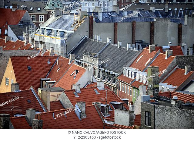 View of city roofs from Rundetaarn, or the round tower, 17th century tower and observatory, the oldest functioning observatory in Europe, Copenhagen, Denmark