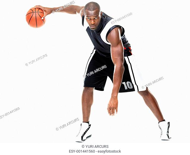 Portrait of a young male basketball player in action against white background