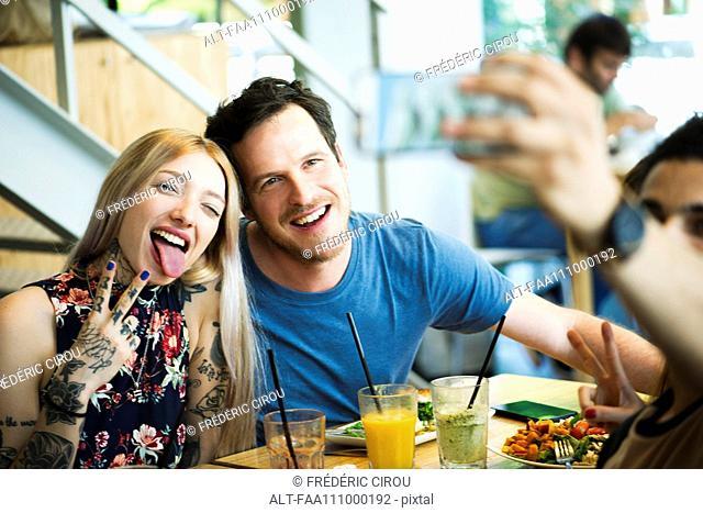 Couple posing for selfie in restaurant