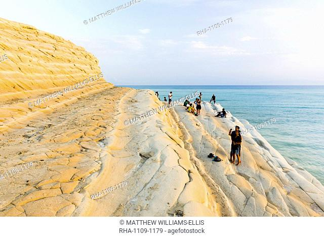 Scala dei Turchi, tourists relaxing at sunset, Rossello Cape, Realmonte, Agrigento, Sicily, Italy, Mediterranean, Europe