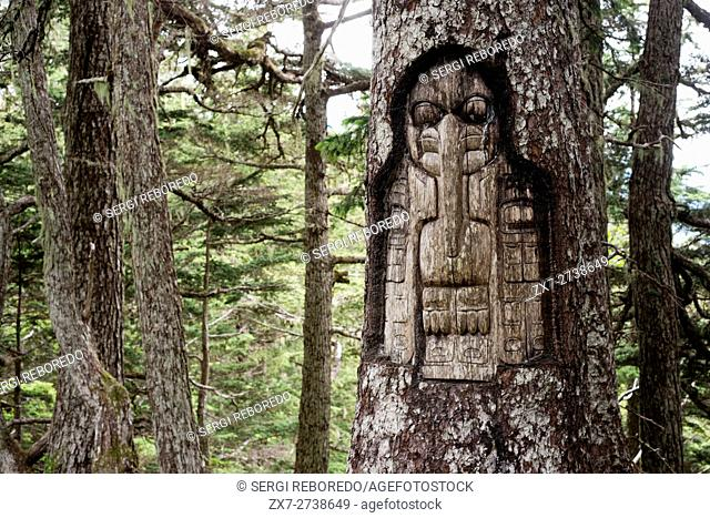 Sign, The Raven clan territory, tree carving, Tlingit Indians, Juneau, Southeast Alaska. Mount Roberts. Trekking from the Mt Roberts Tramway, Juneau
