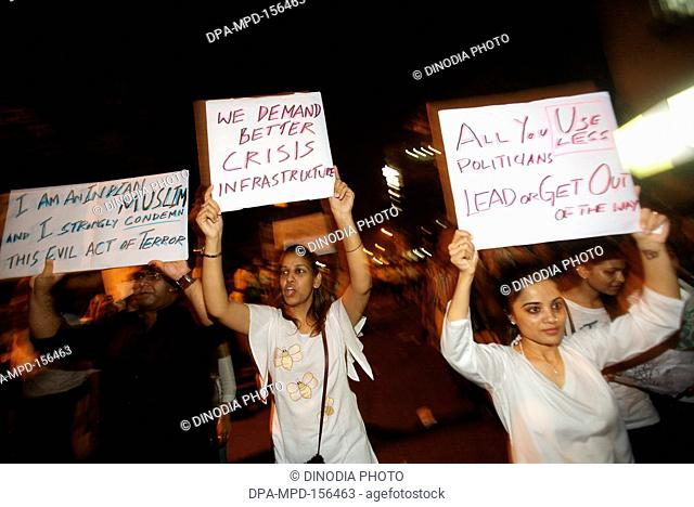 Thousands of Mumbaikars took part in mass protest march at Gateway-of-India after terrorist attack by Deccan Mujahedeen on 26th November 2008 in Bombay Mumbai ;...