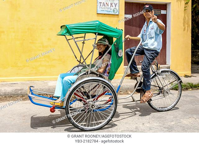 Female Tourist In A Cycle Rickshaw, Hoi An, Quang Nam Province, Vietnam