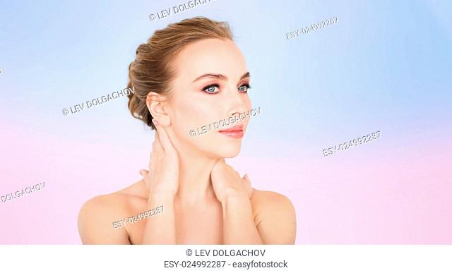 beauty, people and bodycare concept -beautiful young woman face and hands over rose quartz and serenity gradient background