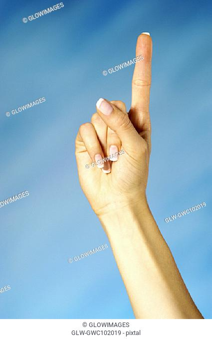 Close-up of a woman holding up one finger