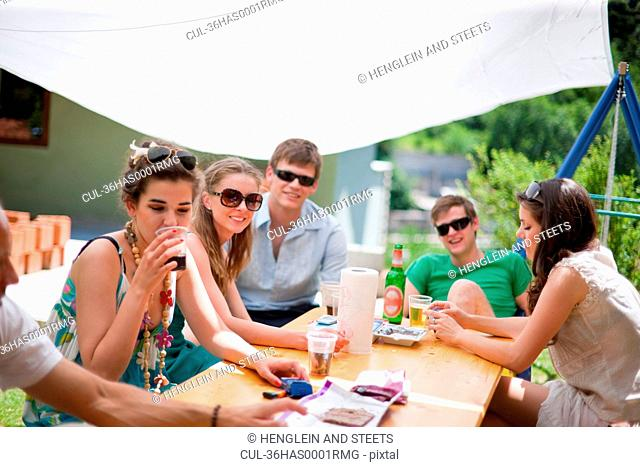 Family talking at table outdoors