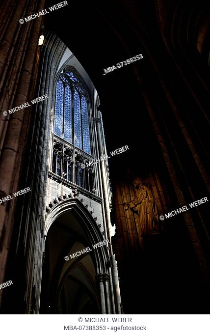 Interior with stained glass window, Cologne Cathedral, Cologne, North Rhine-Westphalia, Germany