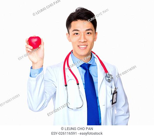 Doctor hold with heart ball