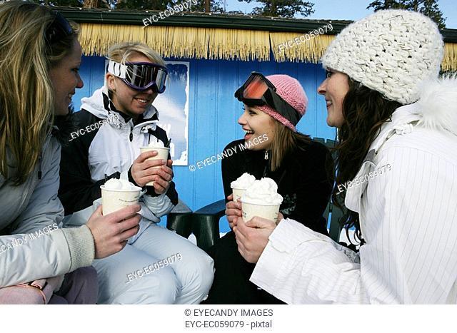 Four women enjoying hot drinks