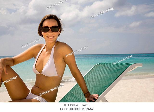 Woman Sunbathing on Sun Lounger
