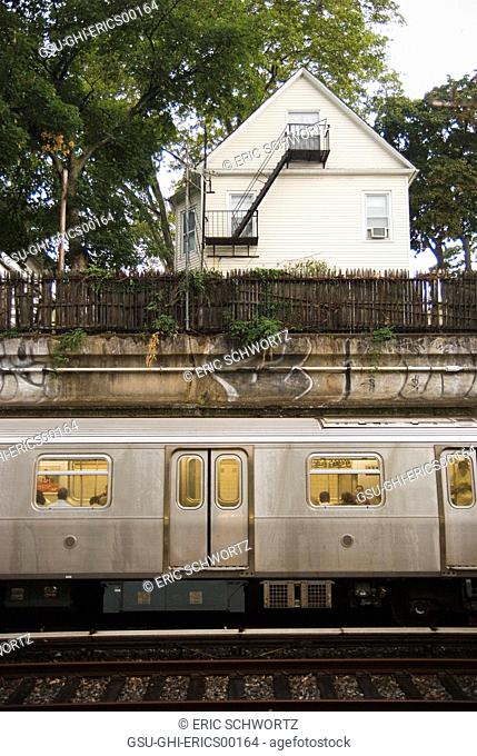 Trees and House Above Subway Train, Brooklyn, New York, USA