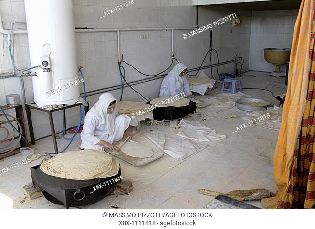 Women making bread in a traditional Baker's shop, Iran