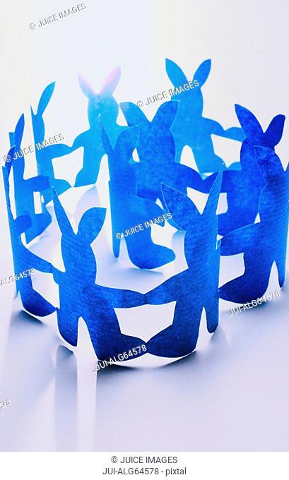 Circle of blue rabbit cutouts