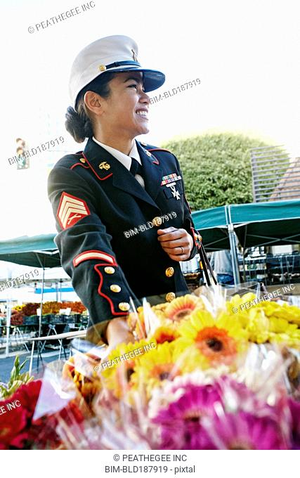 Asian soldier shopping in flower market