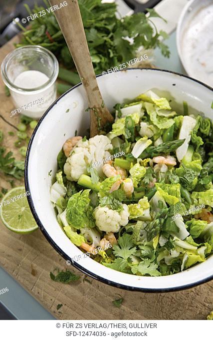 Warm salad with cauliflower and coconut prawns
