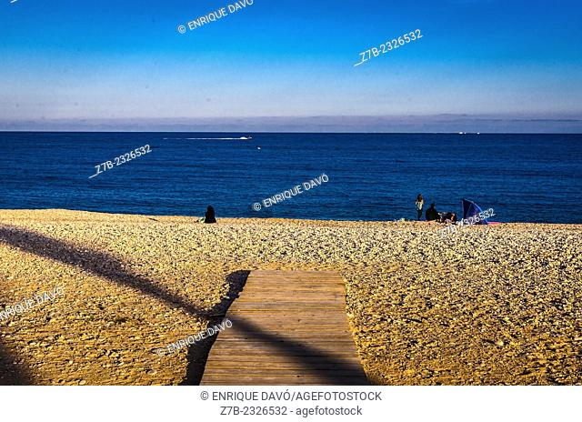 View of a diagonal shadow line on Albir beach, Alicante north, Spain