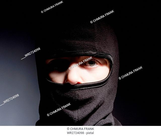 Portrait of a Boy with Hood Playing Ninja