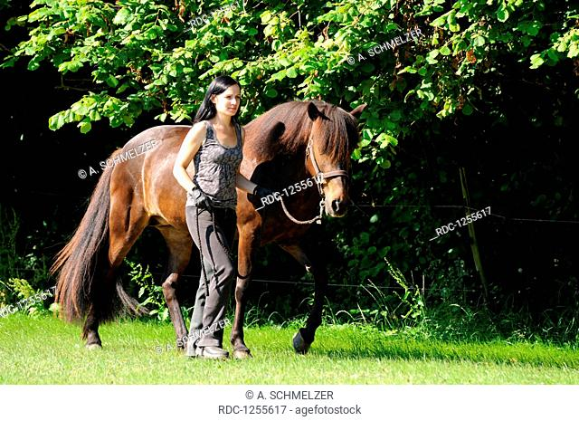 Woman walking with Icelandic Horse