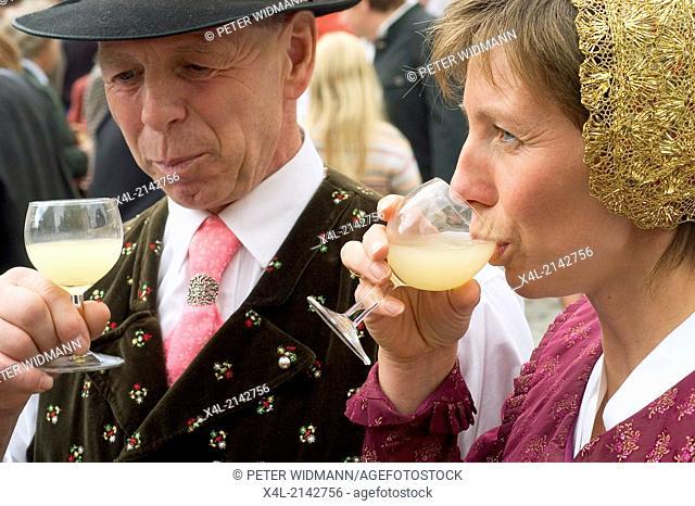 Austria Wachau Spitz harvest festival couple in national costumes drinking Sturm