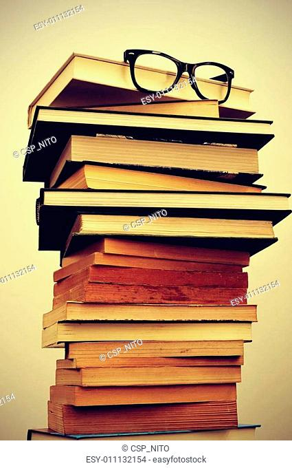 books and eyeglasses