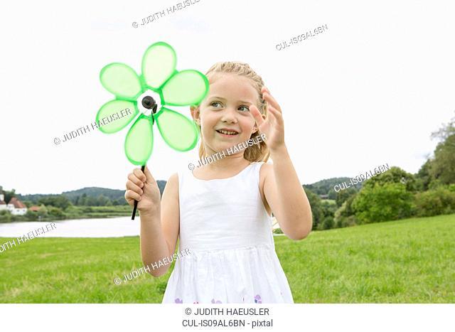 Girl with flower shaped pinwheel