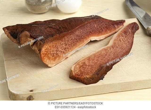 Fresh slice of a beefsteak fungus on a cutting board
