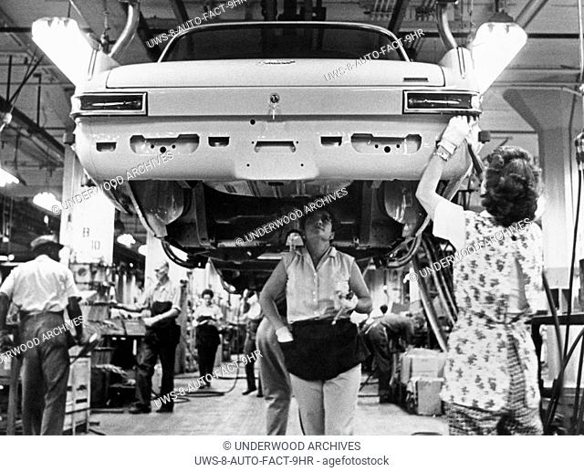 Detroit, Michigan: 1963.Women on working on Plymouth Valiants on the assembly line at the Chrysler Jefferson plant