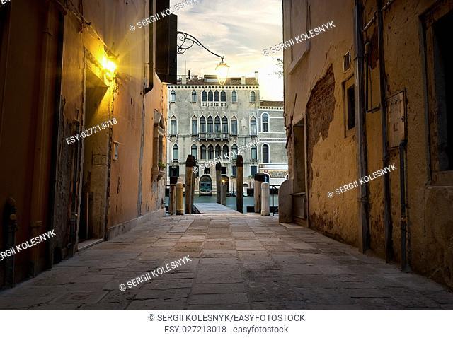 Narrow street in Venice leading to a pier, Italy