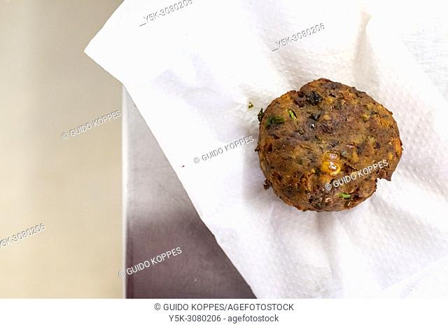 Tilburg, Netherlands. One healthy vegetarian 'meatball' on a napkin, just baked and fried, ready to try