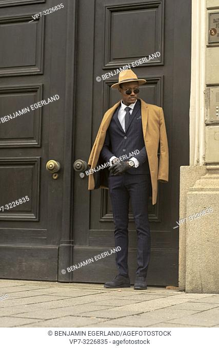 Fashionable man walking in the city. Munich, Germany