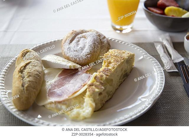 Spanish breakfast: bread, ham, omelette and cheese