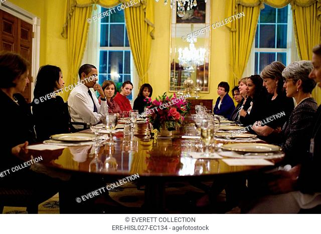 President Obama attends a women's dinner with staff in the Old Family Dining Room of the White House Nov. 5 2009. Among the attendees are Valarie Jarrett Mona...