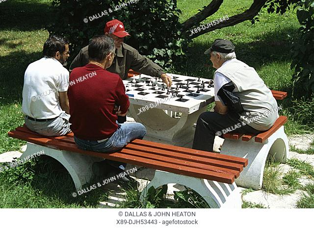 Romania,Transylvania, Brasov County, Brasov, Central Park, Men Playing Chess