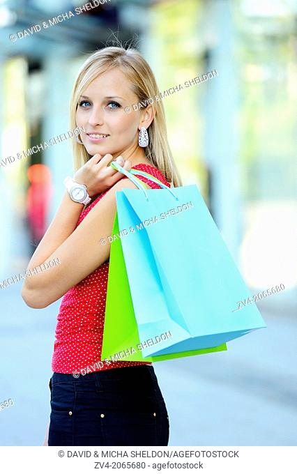 Young woman shopping in a town outdoors